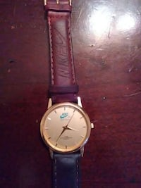round gold face Nike Analog watch with brown leath need a battery Baltimore, 21213