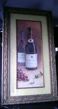 Ornate frame with wine art