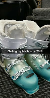 teal-and-white Lange ski boots