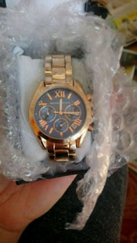 round gold chronograph watch with link bracelet Calgary, T1Y