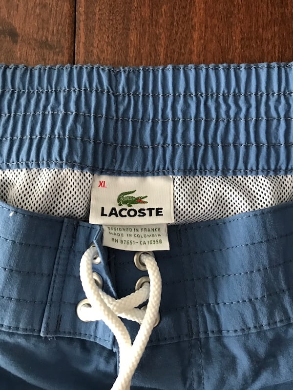 Lacoste swim shorts (size XL) 1
