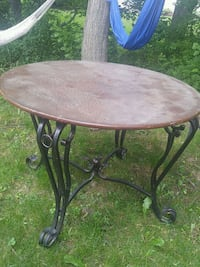 round brown wooden table with black metal base Dartmouth, B2W 5Z9
