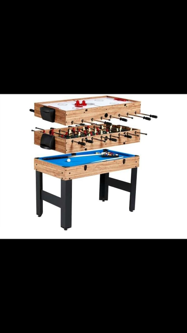 brown and blue foosball table screenshot 1683479c-035f-4aac-b47c-2cbed6bfba65