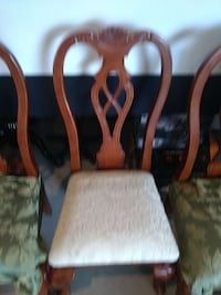 brown wooden dinning chair frames with green and white cushions 102 mi