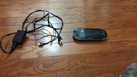 Black psp with adapter