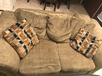 Moss green couch and love seat set