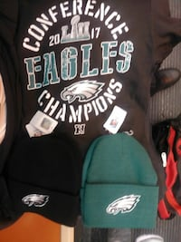 black Philadelphia eagles shirt and two knit caps