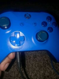 blue and black Xbox One controller 615 mi