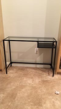 "Glass top narrow desk/table 14""1/4 deep, 39""1/2 long, 29"" high. Metal frame"