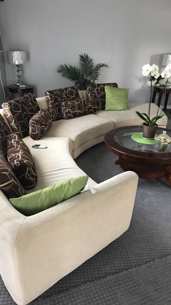 Round Sectional and pillows and table good condition