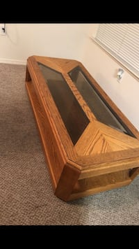 brown wooden framed glass top coffee table Fresno, 93706