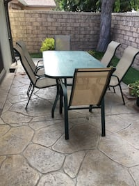 Green patio glass top table w/ 6 stackable chairs. Ventura, 93003
