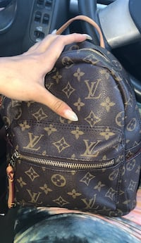 brown Louis Vuitton monogram leather backpack Omaha, 68134