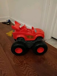 red and black plastic toy car