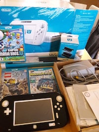 Wii u comes with 3 games Palmetto, 34221