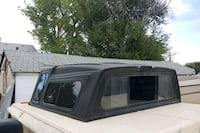 black and gray camper shell Englewood, 80110