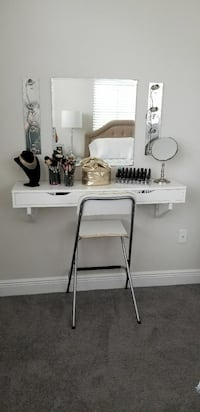 white wooden desk with wall mirror