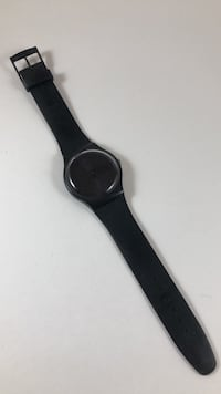 Swatch wrist watch black wristband midnight blue face with date Vienna, 22180