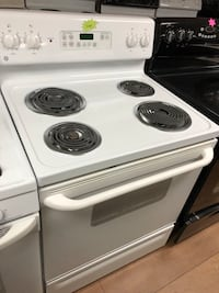 GE white electric coil range stove  47 km