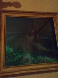 ocean painting with brown wooden frame