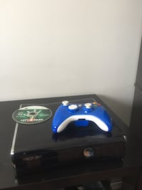 Xbox 360 with controller and 1 game.