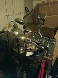 assorted stainless steel golf clubs