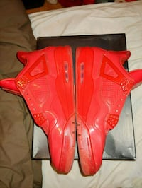 pair of red Nike basketball shoes Arlington, 22204