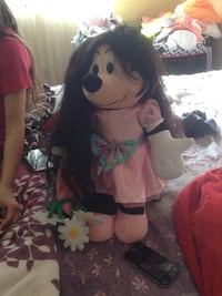 Minnie Mouse wearing pink dress plush toy