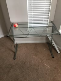 gray metal frame glass top table