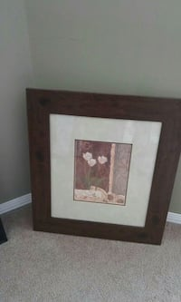 white flowers painting with brown wooden frame