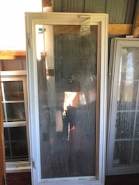 brown wooden framed glass door 456 km