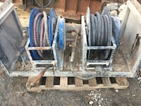 Two blue-and-gray steel hose spools 44 km