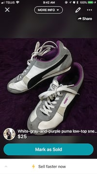 pair of white-and-black Nike basketball shoes Calgary, T2A 3P3