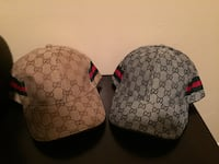 two black and gray Gucci caps Houston, 77074