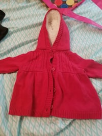 toddler's red zip-up hoodie null