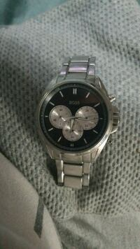 round silver chronograph watch with silver link bracelet Edmonton, T6W 0V4