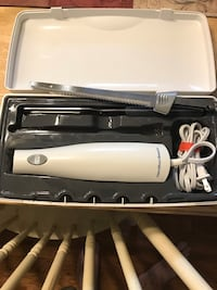 white and black hair curler in box Westminster, 21157