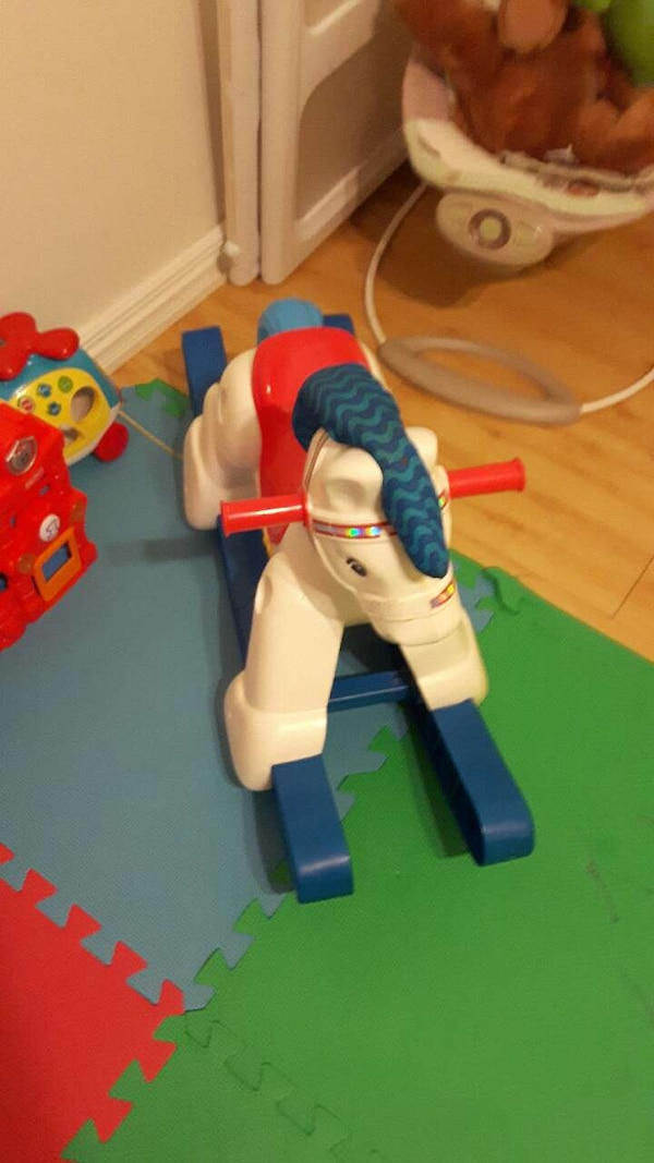baby's red, white and blue rocking horse toy