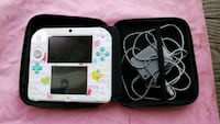 white Nintendo DS with case 446 mi