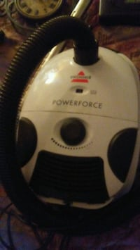 white and black Arcelik canister vacuum cleaner 2929 km