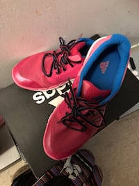pair of red Adidas running shoes Longueuil, J4L 4C8