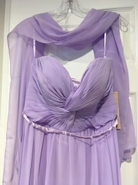 Brand new Dress size L we order the wrong size and we can't retuned it, the original price is $125