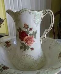 white and red ceramic pitcher