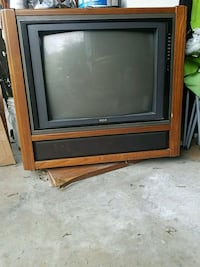 gray CRT television with brown wooden TV hutch Manheim, 17545