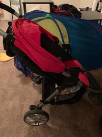 baby's red and black stroller 921 mi