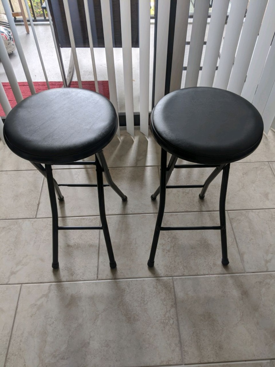 Photo Two Black Stools, 24 inches tall, Collapsible