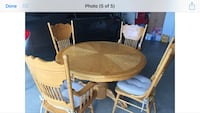 Round brown wooden table with four chairs dining set Prescott Valley, 86327