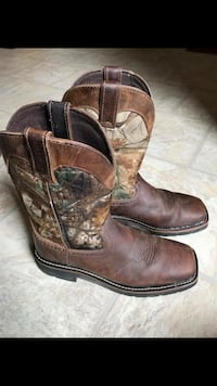 pair of brown leather cowboy boots Louisville, 40229