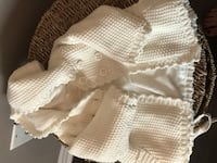 White knitted textile used for a baptism, very new