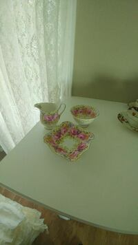 white, pink and green floral print ceramic pitcher, bowl and plate set